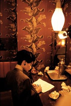 "Maggie Cheung, in a scene of ""In the mood for love"""