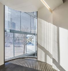 Dogok Office Remodeling / DIA Architecture  I-beams and Expanded Metal Mesh Shadow create industrial look.