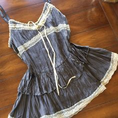 BEAUDOIS BEAUTIFUL VINTAGE  SILK. Med. like new Worn twice beautiful silk like new top by Beaudois. Gorgeous with lace and tie back in back. Hangs down to hips. So flattering enhanced with cream colored lace. Adjustable straps. Medium Vintage Tops