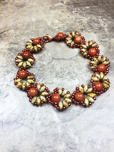 Brown flower super duo beaded bracelet, perfect combination goldstone beads and…