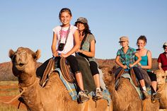 Ride a camel at sunset down Broome's Cable Beach