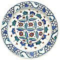 An iznik polychrome pottery dish with stylised cloud and cintamani design, turkey, circa 1580-85