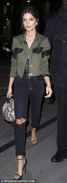 So nice, she wore it twice! She covered up from the breezy California chill in a cropped army green jacket, which she had rocked a few days ago in Milan with a similar outfit