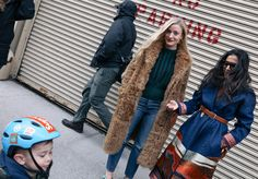 Kate Foley (left) in a Sandy Liang coat, Marni top, and Frame jeans and Nausheen Shah in Etro