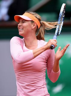 Maria Sharapova Photos: French Open: Day 4. Maria Sharapova of Russia returns a shot during her women's singles match against Tsvetana Pironkova of Bulgaria on day four of the French Open at Roland Garros on May 28, 2014 in Paris, France.