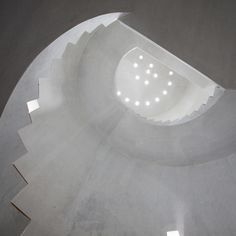 Spiralling staircase winds up an empty tower by Marra + Yeh Architects. S)
