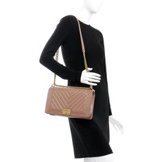 c136445b0d70fc This is an authentic CHANEL Calfskin Chevron New Medium Boy Flap in Beige.  This chic
