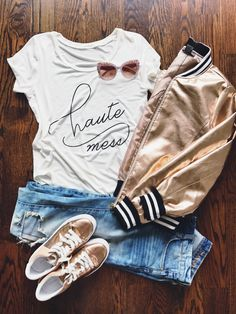 Bomber jacket + ripped jeans outfit.