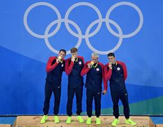 Townley Haas, Conor Dwyer, Ryan Lochte and Michael Phelps of the U.S. kiss their gold medals for the men's 4 x 200m freestyle relay on day four of the Rio 2016 Olympic Games on Aug. 9. The relay gold is No. 21 for Phelps and his 25th medal overall across five editions of the Games.