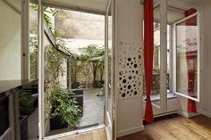 Vue depuis l'intérieur vers la terrasse - Olivier Olindo Architecte