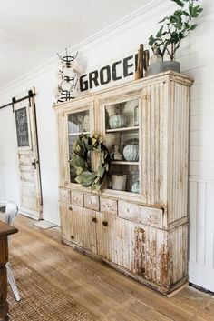 Primitive Dining Room Hutch. Neutral Farmhouse Dining Room. Shiplap Walls,  Primitive Furniture,