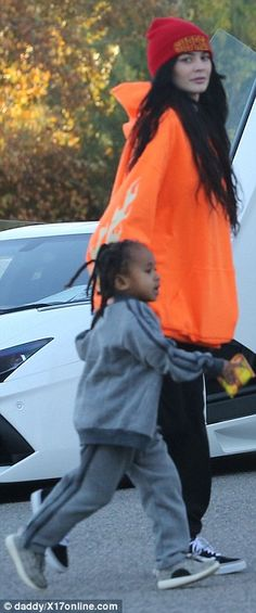 Aww: King Cairo, who is from Tyga's previous relationship with Blac Chyna, wore a grey sweatshirt and matching trousers
