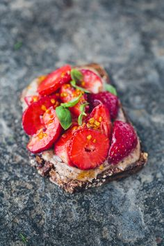 Hazelnut butter, sliced strawberries, a drizzle of honey or maple syrup, a sprinkle of bee pollen and some fresh basil on toast