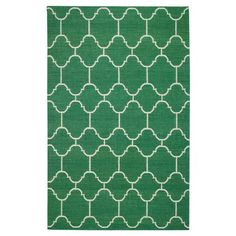 Add emerald green to your home decor with an area rug #LoveYourSpace