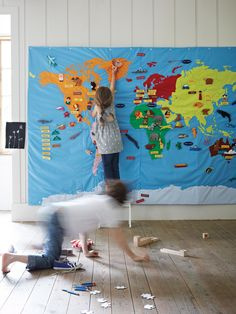 Giant Wall Map (Can't find online for sale...and it says around $500. Could make with velcro-backed picture and word motifs, maybe using felt and/or laminated pictures, of categories - oceans, countries, capital cities, famous buildings and wild animals...)