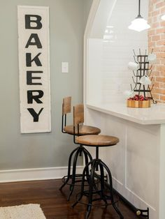 A portion of the wall between the dining room and kitchen was removed making room for this breakfast nook and bar-top with stools for additional seating.