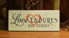 Love Endures All Things Painted Wood by 2ChicksAndABasket on Etsy, $10.95