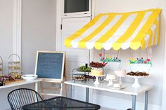 French cafe Party- love the awning, chalkboard, gifts in the bicycle's basket, wall of faux frame art, etc... great ideas (oh and a mime!)