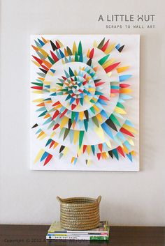 DIY tutorial: use paper scraps to make wall art  -- from A Little Hut    I know it's not actually 'quilty' but I can totally see it made with 3D fabric triangles, all sewed down in that spiral. Might be cool to try.