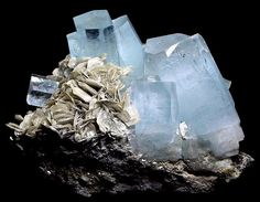 Exceptional specimen of Aquamarine on matrix with Muscovite.  No damage anywhere with full, complete terminations & very good color.  This cluster features 7 separate terminations & displays very aesthetically.  Measures 11cm by 14.5cm.  From Chumar Bakhoor, Nagar, Pakistan.  From the J. Vivero Collection. Exceptional Minerals.