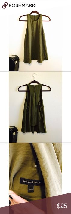 Banana Republic flowy military green tank Purchased at Banana Republic. This top is a size Small but can fit a Medium. With open slots on each side, revealing a lighter layer underneath. This top is perfect for every season. Worn a few times but it PERFECT condition. • If you have any questions, go ahead and ask away 💕 • Banana Republic Tops Tunics