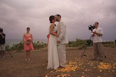 The first kiss, after a sunset ceremony.