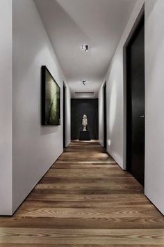 As I'm drooling over the beautiful natural wood flooring, I notice the creepy little girl standing at the end of the hallway.
