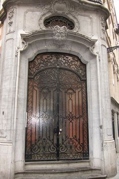 Wrought-iron door - Brussels, Belgium.. Love the door but face above.. A bit creepy eh ?