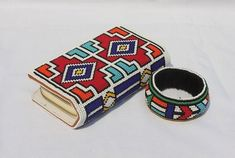 ndebele beaded purse and bangle, zulu beads, african jewelry Ethnic Jewelry, African Jewelry, Beaded Purses, Beaded Bags, Bead Loom Patterns, Beading Patterns, African Print Dress Designs, African Accessories, Baby Fabric