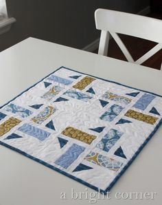 Division quilt pattern made as a table topper found at A Bright Corner