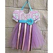An intricate pink, purple and turquoise Moroccan pattern adds a vintage touch to this purple tulle tutu bow holder from the Modern Vintage collection by Caden Lane. It makes a great baby gift because it adds a decorative touch while keeping her bevy of bows and clips organized and handy.  #timelesstreasure