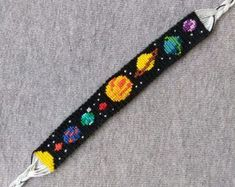 solar system - planets - galaxy - space - friendship bracelet This bracelet gives you the perfect opportunity to express how much you love planets and space. (Possibly aliens.) The basic size of my bracelets 14 cm / inch, but its adjastable thanks to Bracelet Fil, Bracelet Crafts, Jewelry Crafts, Embroidery Bracelets, Beaded Bracelets, Diamond Bracelets, Chain Earrings, Diy Embroidery, Charm Bracelets