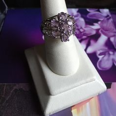 NEW STERLING & AMETHYST 7 STONE FLORAL RING THIS RING IS A SIZE 8, HAS A WIDE BAND,  SCROLL DESIGNED NEAR 7 PRONG SET OVAL AMETHYST STONES. A GREAT RING TO ADD TO YOUR COLLECTION!!✨ SPECIAL PRICE $65!! Sterling Silver Jewelry Rings