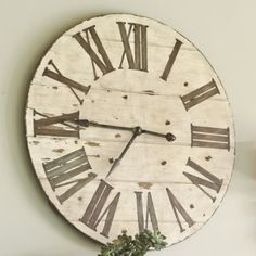 Lanier Wall Clock:  Big warmth on a grand scale. This wall clock is a welcome addition to any wall space where you want to make a big impact. Crafted of wood and hand finished in antiqued ivory with distressed edges and dark chestnut undertones.