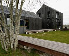 Part of a Latvian, riverside compound - rustic outside, modern inside.: