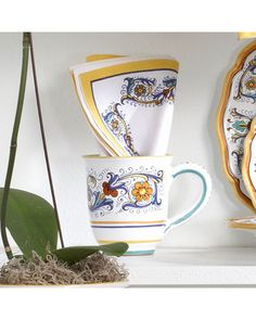 -Sur La Table-  deruta-style mug  $14.95 at Sur La Table    Inspired by the Umbrian region of Italy, our Deruta-style earthenware is crafted in a style that dates back to the Renaissance, showcasing the palette of its namesake city. Dishwasher safe. Made in Italy.