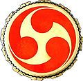 A mitsudomoe design on a taiko drum (note the negative space in the center forms a triskelion) A tomoe is a Japanese abstract shape described as a swirl that resembles a comma or the usual form of a magatama.