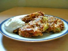 Zucchini Fritters - my zucchini critical husband loved these!!!  i squeezed the zucchini dry with my bare hands :)  instead of sour cream, i served them korean style with a soy based korean dipping sauce. delish!