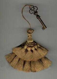Gold metallic Italian key tassel