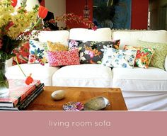White couch + bright bold accent pillows~ perfect by corine