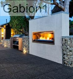 out door gabion fireplace and retaining wall -- I can imagine how nice this would be in my yard!