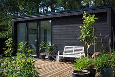 Black painted house exterior surrounded by plants and fruit trees. Garden Cabins, Black House Exterior, Garden Buildings, Celebrity Houses, House Painting, Architecture, Outdoor Gardens, Outdoor Living, House Ideas