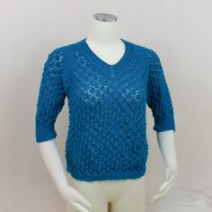 This turquoise lace top has 3/4 sleeves (three quarter sleeves) and is very lightweight. With a V neck and raglan sleeves, this blue sweater is #lacetop #sweater #womensweater #threequartersleeve #vneck #raglantop #blue #turquoise #top