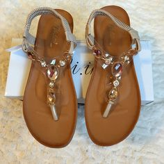 Beige Sandals w/Rhinestone Embellishments Beige/nude sandals with rhinestone embellishments. Brand new in box. Tag says size 10, but they RUN SMALL. Would fit better for a size 9 1/2 or even a 9. Shoes Sandals