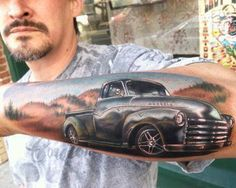Realistic 3D old car tattoo on arm