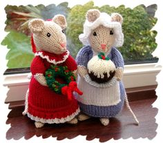 This adorable little pair of Christmas mice are guaranteed to be a talking point in your Christmas decorations. They are very carefully knitted and adapted from an Alan Dart pattern. They stand about 7 inches high. The lady of the house is busy with decorating, getting ready to hang her holly wreath decorated with its red bow. She wears her best red party dress which is trimmed with shiny white and has a pretty red bow on her head. The cook is bringing in the Christmas pud on a silver…
