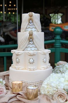 Elegant Pale Pink Wedding Cake with Gold Jewels