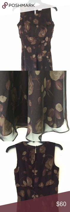 "Ann Taylor Floral Maxi Dress Ann Taylor Floral Maxi Dress. Brown floral print over full lining. Side zipper; buttons at neck. Approximately 53"" long on hanger. New without tags. Ann Taylor Dresses Maxi"