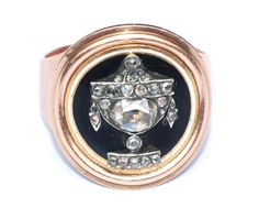Most elegant Georgian mourning ring, circa 1780. A wide tapering band of gold is set with a central enamel panel of black bordered by white and overlaid with an urn studded with foiled, rose-cut diamonds, set silver. There is a locket compartment to reverse. The ring is size N [US 6 and 1/2] and the front panel measures 2/3 of an inch by 2/3 of an inch. A superior quality Georgian mourning jewel in immaculate condition.