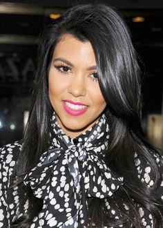 Kourtney Kardashian looking adorable in this high necked shirt and pink lipstick